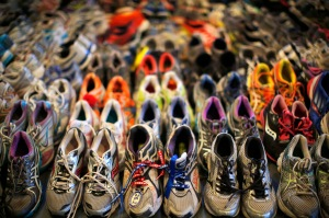 "Running shoes left at the makeshift memorial following the 2013 Boston Marathon bombings are displayed in an exhibit titled ""Dear Boston: Messages from the Marathon Memorial"" at the Boston Public Library in Boston, Massachusetts. (Brian Snyder/Reuters)"